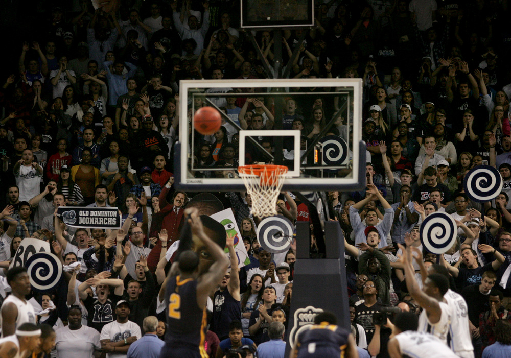Old Dominion fans distract Murray State's Jonathan Fairell during a free throw attempt in ODU's 72-69 win in an NCAA college basketball game in the National Invitation Tournament, Wednesday, March 25, 2015 in Norfolk, Va.  (AP Photo/Jason Hirschfeld)