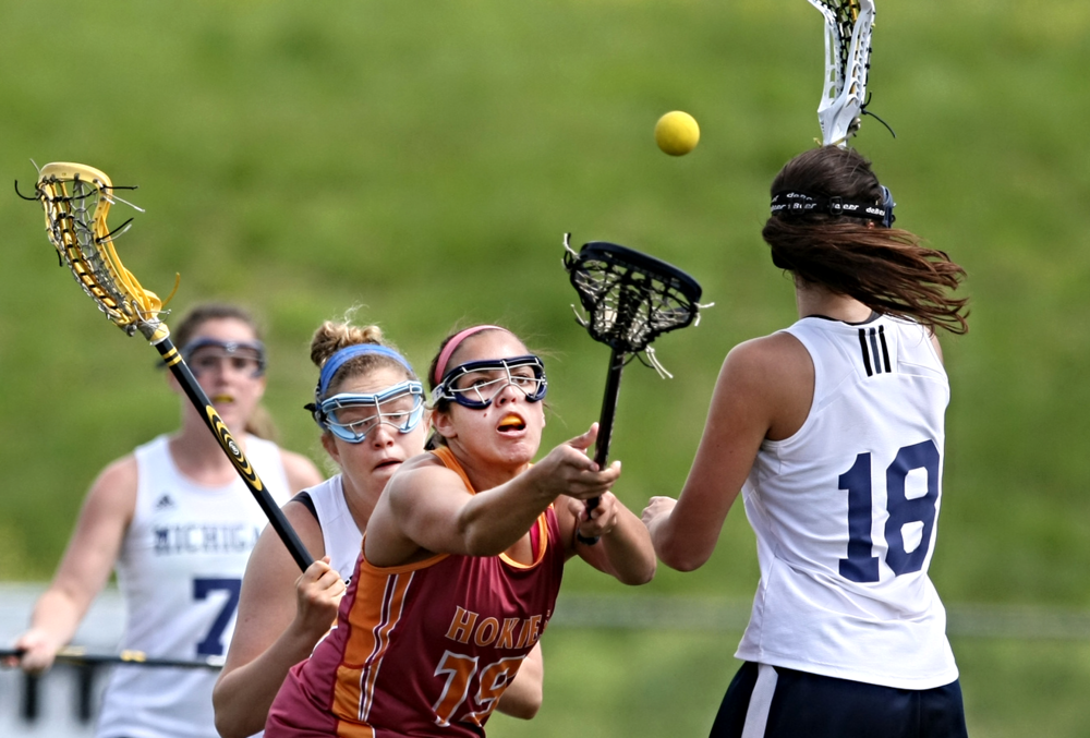 Virginia Tech's Chelsea Denton (19) battles Michigan's Shannon Childress (18) for a loose ball during the women's national lacrosse championship,. Saturday, May 9, 2015 at the Sportsplex in Virginia Beach. (AP Photo/Jason Hirschfeld)
