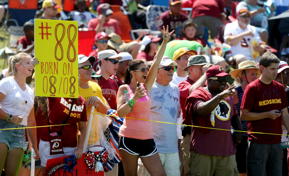 Washington Redskins fans line the sidelines during the team's NFL football training camp in Richmond, Va., Saturday, August 1, 2015.  (AP Photo/Jason Hirschfeld)