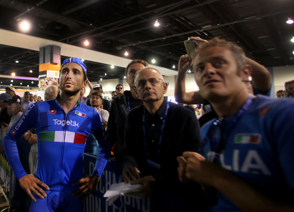 Moreno Moser, of Italy, watches his results on a monitor with team members after finishing the men's elite time trials at the UCI Road World Championships Cycling Races in Richmond, Va., Wednesday, Sept. 23, 2015.  (AP Photo/Jason Hirschfeld)
