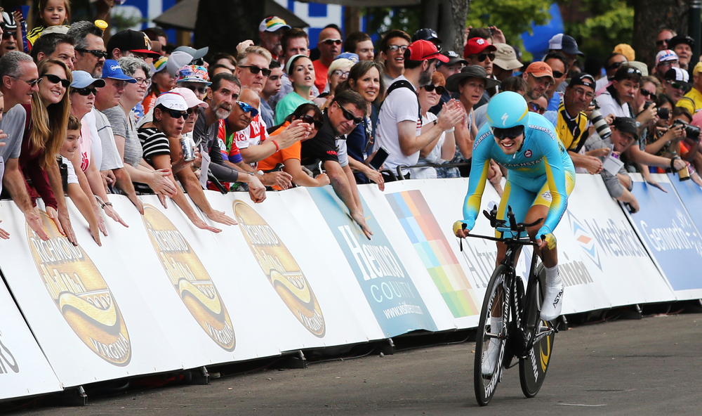 Daniil Fominykh, of Kazakhstan, crosses the finish line during the men's elite time trial at the UCI Road World Championships cycling races in Richmond, Va., Wednesday, Sept. 23, 2015.  (AP Photo/Jason Hirschfeld)