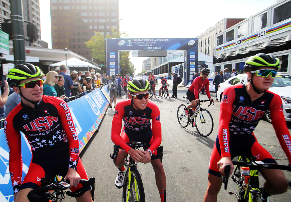 USA cyclists Logan Owen, left, Daniel Eaton, center and Greg Daniels before heading out for the Road Circuit Training portion of the UCI Road World Championships cycling races in Richmond, Va., Thursday, Sept. 24, 2015.  (AP Photo/Jason Hirschfeld)