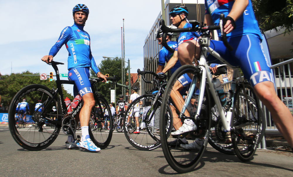 Members of the Italian cycling team take a break during he Road Circuit Training portion of the UCI Road World Championships cycling races in Richmond, Va., Thursday, Sept. 24, 2015.  (AP Photo/Jason Hirschfeld)