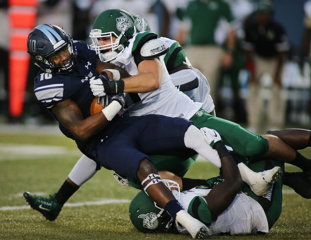 Old Dominion's David Washington is brought down by Charlotte's Nick Carroll in the third quarter of ODU's 37-34 win , Saturday, Oct. 17, 2015 at Foreman Field in Norfolk.   (Jason Hirschfeld | For The Virginian-Pilot)