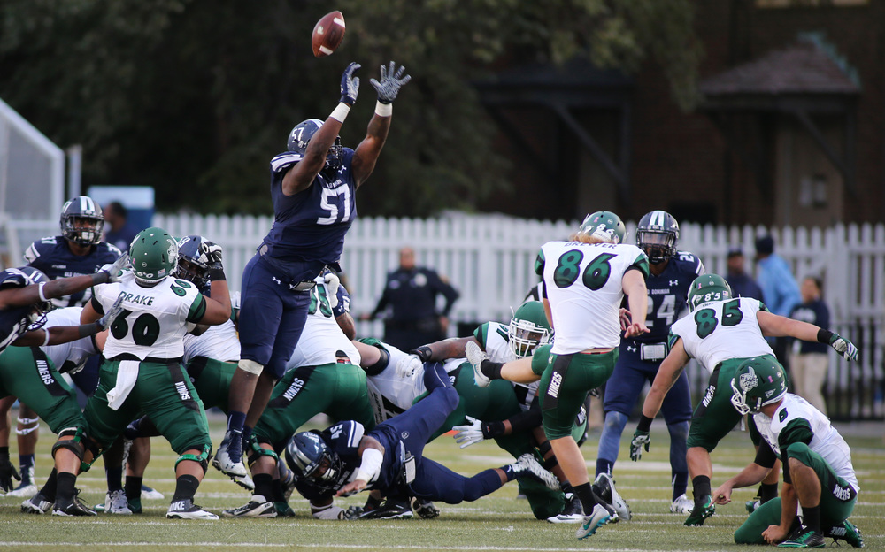 Old Dominion's Rashaad Coward blocks a field goal attempt by Charlotte's Blake Brewer in the third quarter of ODU's 37-34 win, Saturday, Oct. 17, 2015 at Foreman Field in Norfolk.   (Jason Hirschfeld | For The Virginian-Pilot)
