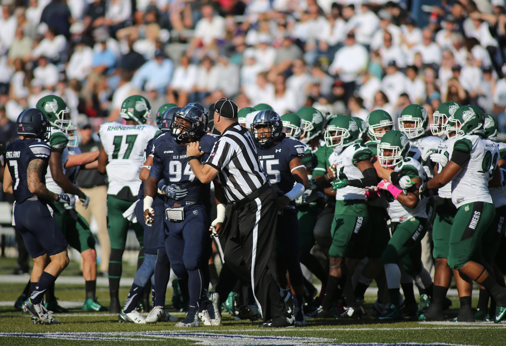 Officials break up a skirmish between Old Dominion and Charlotte in the first quarter, Saturday, Oct. 17, 2015 at Foreman Field in Norfolk.   (Jason Hirschfeld | For The Virginian-Pilot)