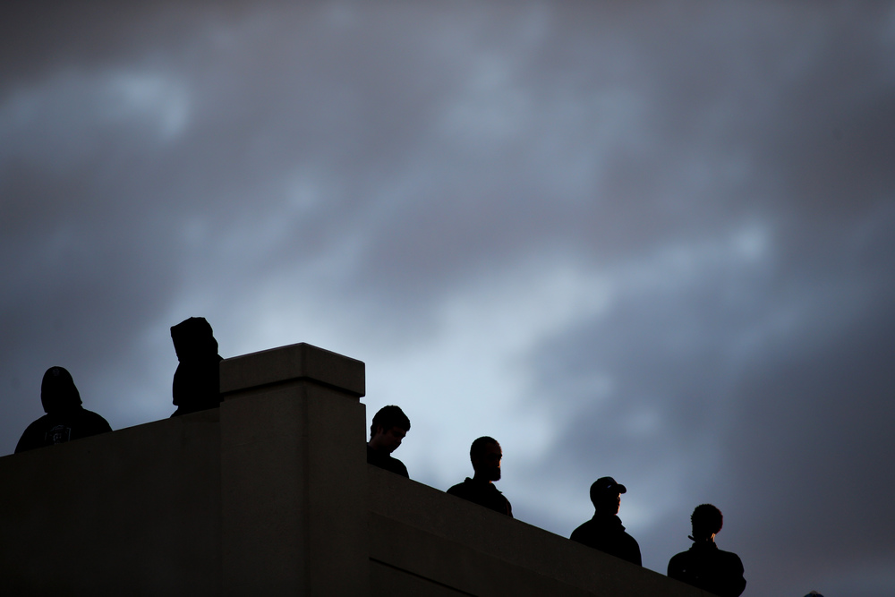 Old Dominion football fans watch the game against Charlotte from the top of the adjacent parking garage, Saturday, Oct. 17, 2015 at Foreman Field in Norfolk.   (Jason Hirschfeld | For The Virginian-Pilot)