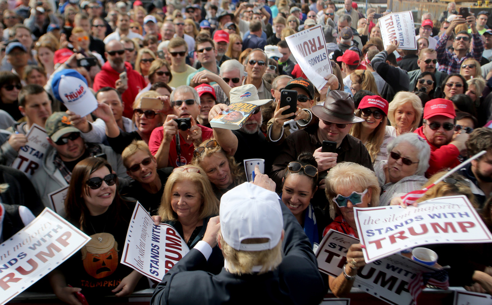 Republican presidential candidate Donald Trump signs autographs for supporters during a rally, Saturday, Oct. 31, 2015 in Norfolk, Va.   (AP Photo/Jason Hirschfeld)