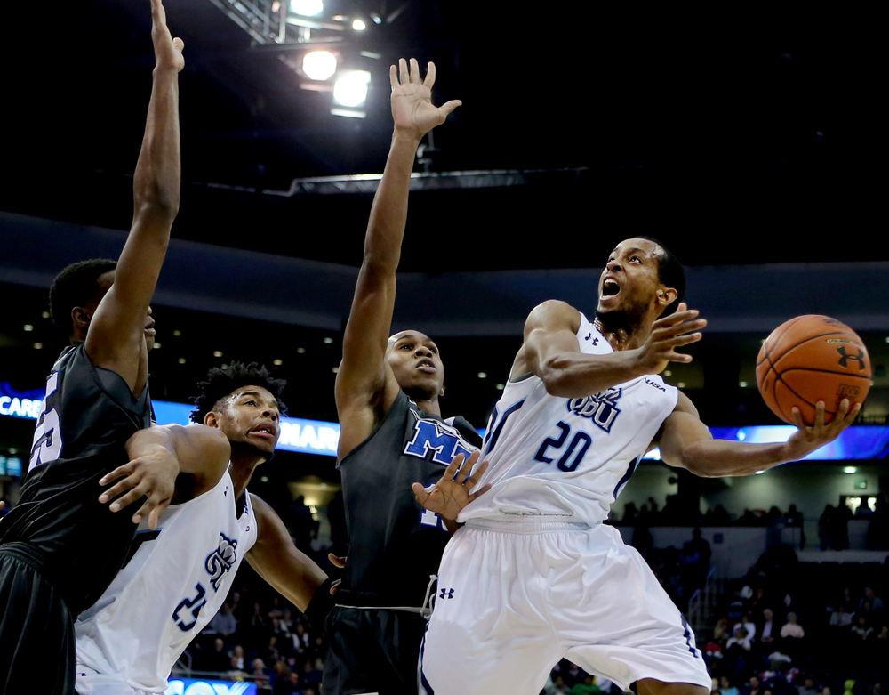 Old Dominion's Trey Freeman, right, shoots over Middle Tennessee's Jaqawn Raymond for two of his game-high 28 points in ODU's 64-61 loss, Saturday, Jan. 16, 2016 at the Constant Center in Norfolk. (Jason Hirschfeld | For The Virginian-Pilot)