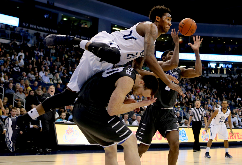 Old Dominion's Zoran Talley, top left and collides with Middle Tennessee's Reggie Upshaw while going after a loose ball in the second half of ODU's 64-61 loss, Saturday, Jan. 16, 2016 at the Constant Center in Norfolk. (Jason Hirschfeld | For The Virginian-Pilot)