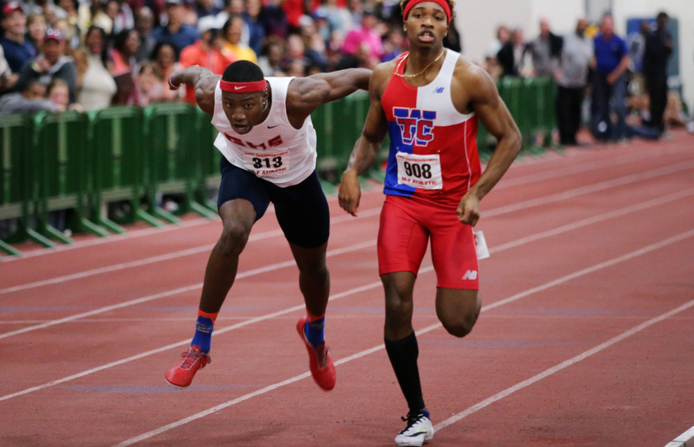 Grassfield's Grant Holloway, left, lunges for the finish line to win the 500-meter relay during the indoor track championships, Saturday, Feb. 27, 2016 in Hampton. (Jason Hirschfeld | The Virginian-Pilot)