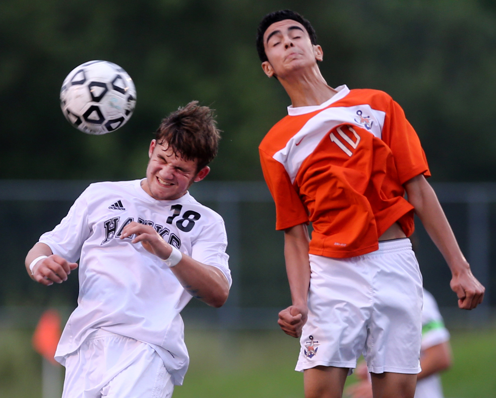 Hickory's Daniel Eads, left, and Maury's Ali Jammi vie for a header during the Hawks' 2-0 win to advance in the Group 5A South Region semifinals, Wednesday, June 1, 2016 at the Sportsplex in Virginia Beach.