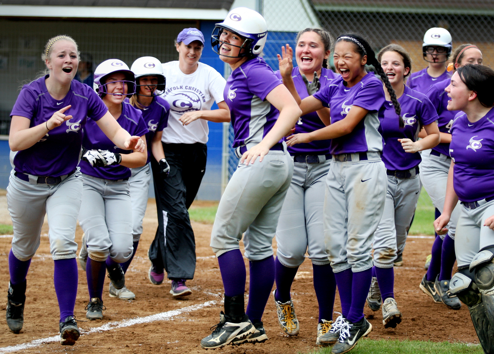 Norfolk Christian's Rilee (cq) Jones, center, is mobbed by teammates after belting a three-run homerun in the top of the fifth inning but fell to Nansemond-Suffolk 4-3 in the TCIS semifinal, Thursday, May 12, 2016 in Suffolk.