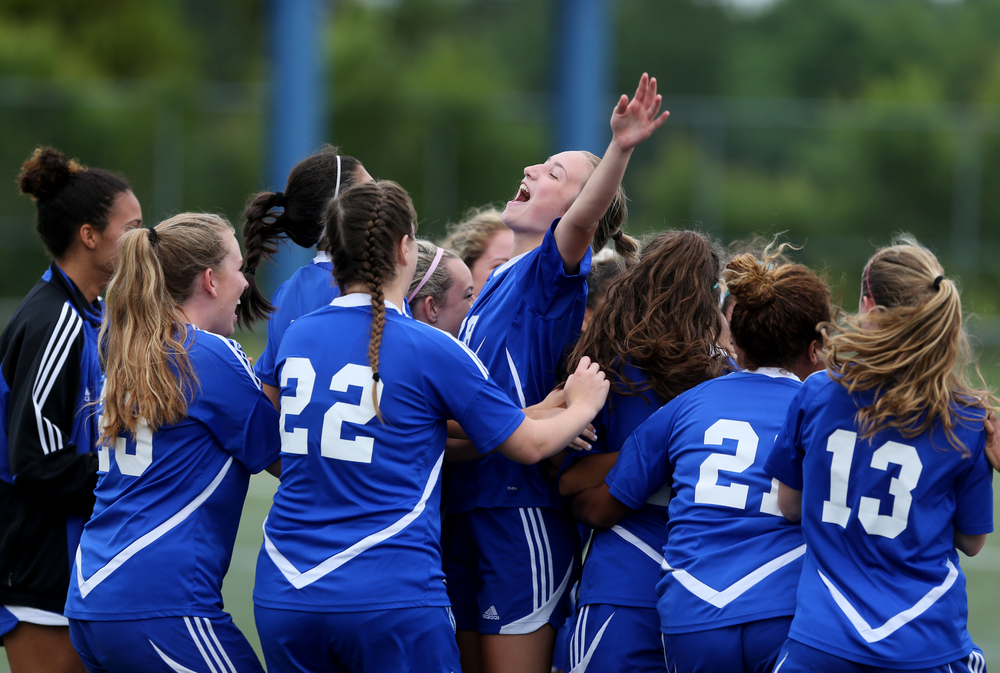 Princess Anne's Hannah Davenport, center, celebrates with her teammates after beating Maury 1-0 to advance in the Group 5A South Region semifinals, Wednesday, June 1, 2016 at the Sportsplex in Virginia Beach.