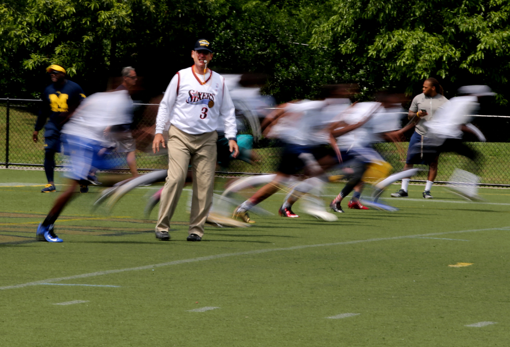 Michigan head football coach Jim Harbaugh runs a drill during a satellite camp held at ODU, Sunday, June 5, 2016 in Norfolk.