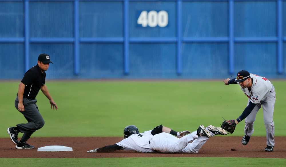 Norfolk's Mike Yastrzemski slides safely into second base under the tag of Pawtucket's Deven Marrero in the bottom of the first inning and would come around to score for the first run of the game, Thursday, June 2, 2016 at Harbor Park in Norfolk.