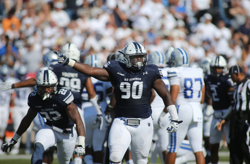 Old Dominion's Miles Fox, center, celebrates a three-and-out forcing Hampton to punt in the second quarter, Sunday, Sept. 4, 2016 at Foreman Field in Norfolk.  (Jason Hirschfeld | The Virginian-Pilot)