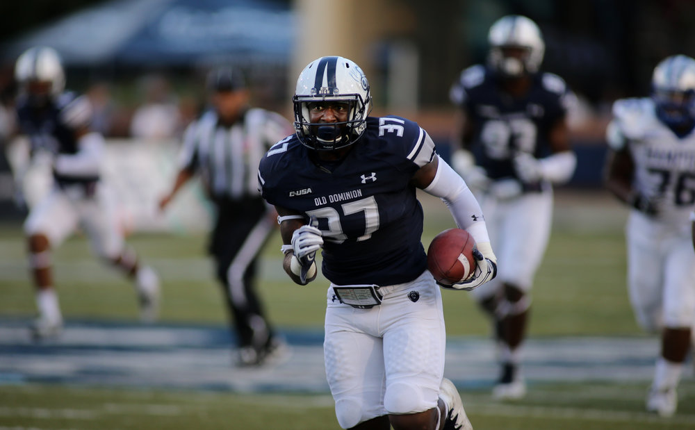 Old Dominion's Marvin Branch runs for a gain in the third quarter of ODU's 54-21 win over Hampton, Sunday, Sept. 4, 2016 at Foreman Field in Norfolk.  (Jason HIrschfeld | The Virginian-Pilot)