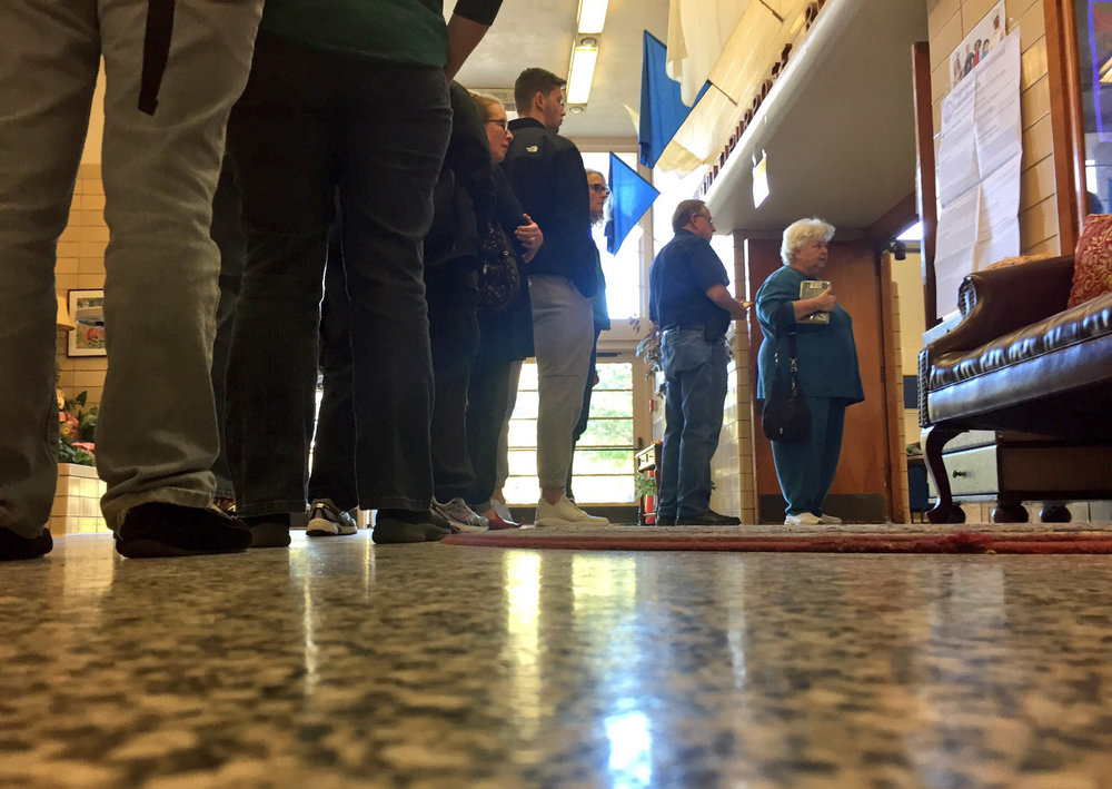Voters wait in line to cast their ballots in the 2016 election at Willard Elementary School in Norfolk, Tuesday, Nov. 8, 2016. (Jason hirschfeld | The Virginian-Pilot)