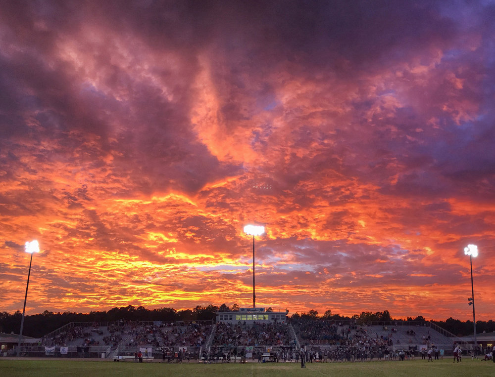 A dynamic sunset takes place during the King's Fork at Hickory football game, Friday, Sept. 10, 2016 at Hickory High School in Chesapeake. (Jason Hirschfeld | The Virginian-Pilot)