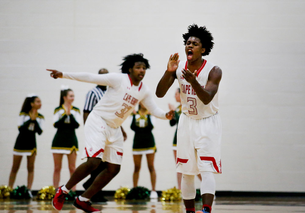 Cape Henry's Iziah James cheers towards the Dolphins student section in the closing minutes of their 83-67 win over Bishop Sullivan to claim the TCIS championship, Saturday, Feb. 26, 2017 at Hampton Roads Academy in Newport News. (Jason Hirschfeld | The Virginian-Pilot)
