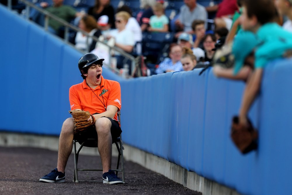 A Tides gameday worker yawns on Opening Night against Gwinnett, Monday, April 10, 2017 at Harbor Park in Norfolk.