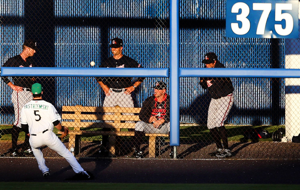 Tides left fielder Mike Yastrzemski plays a fourth-inning double off the wall from Gwinnett's Rio Ruiz as the Braves bullpen watches, Monday, May 15, 2017 at Harbor Park in Norfolk.