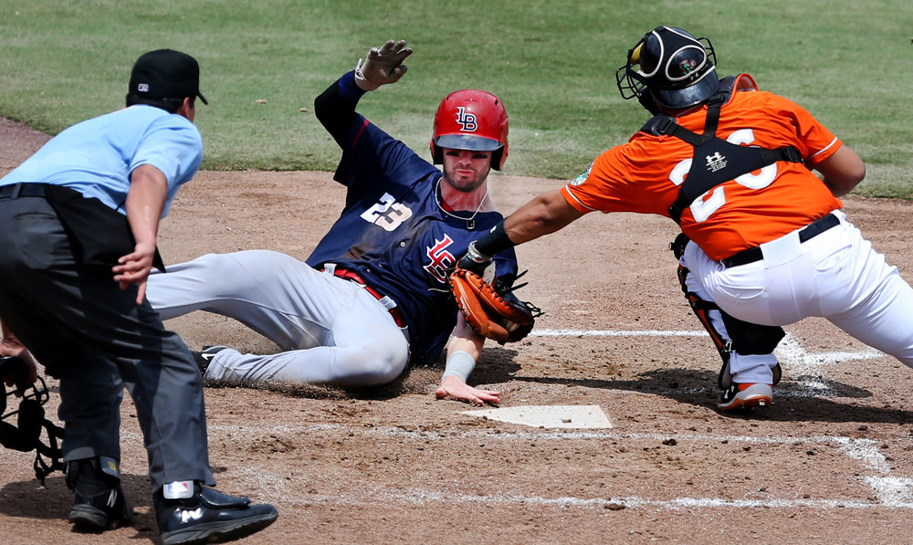 Tides catcher Francisco Pena tags out Louisville's Jesse Winker after centerfielder Craig Gentry threw a strike to home during the Tides' 4-3 walk off win, Sunday, June 18, 2017 at Harbor Park.