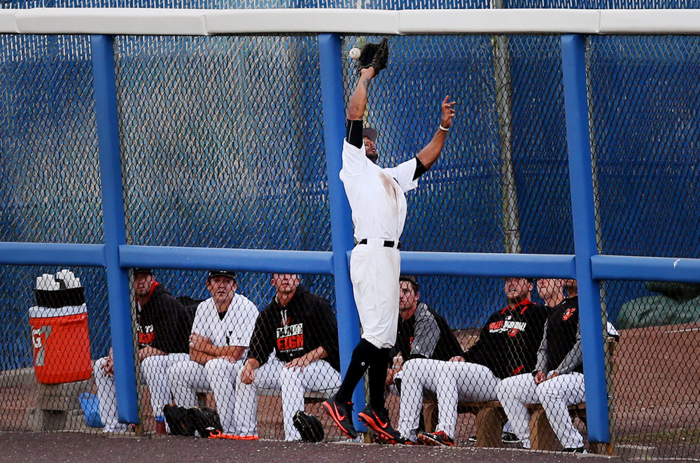 Tides right fielder Chris Dickerson leaps but can't make the catch off the bat of Louisville's Darnell Sweeney in the top of the third inning and the missed ball would plate a run for the Bats, Tuesday, June 27, 2017 at Harbor Park in Norfolk.