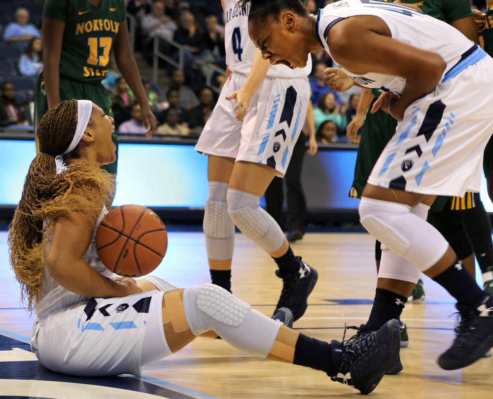 Old Dominion's Destinee Young, right, reacts to Jennie Simms, left, after Simms was fouled on the play and made the basket anyway in a game against Middle Tennessee, Nov. 18, 2016 at the Constant Center in Norfolk