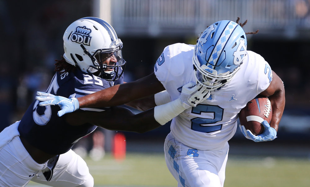 Old Dominion's Denzel Williams (25) wraps up UNC's Jordan Brown (2) during the first half of an NCAA college football game, Saturday, Sept. 16, 2017 in Norfolk, Va.