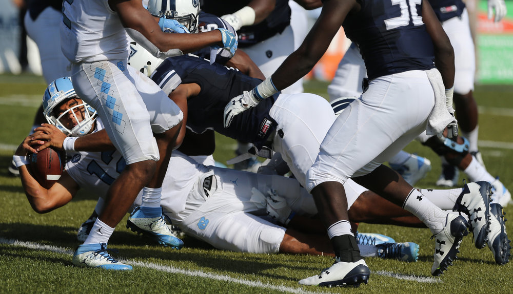 UNC's Chazz Surratt (12) scores a touchdown as the ball crosses the plane during the first half of an NCAA college football game Old Dominion, Saturday, Sept. 16, 2017 in Norfolk, Va.