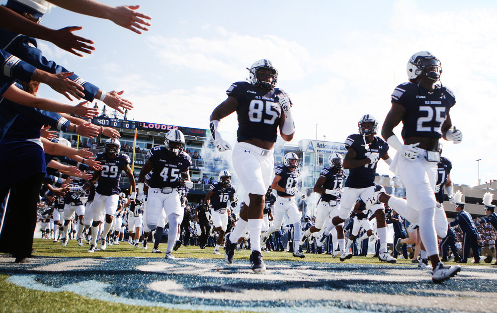The Old Dominion University football team takes the field prior to the start of their NCAA college football game against UNC, Saturday, Sept. 16, 2017 in Norfolk, Va.