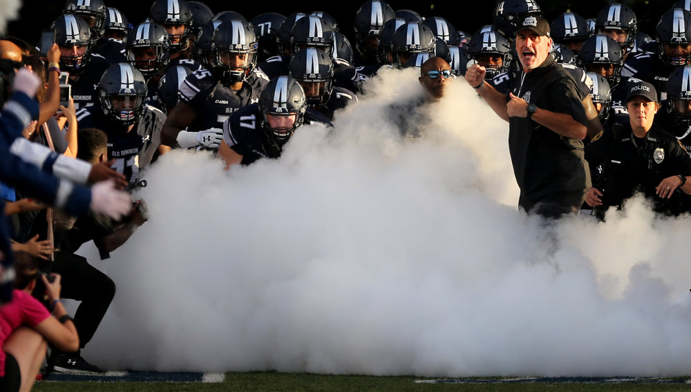 The Old Dominion University football team takes the field prior to the start of their game against Florida Atlantic, Saturday, Oct. 7, 2017 at Foreman Field in Norfolk.
