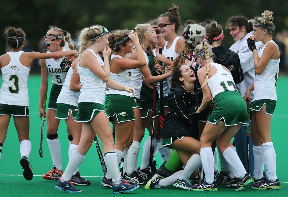 Cox teammates celebrate their 2-1 upset over No. 2 First Colonial, Thursday, Oct. 12, 2017 at the National Training Center in Virginia Beach.