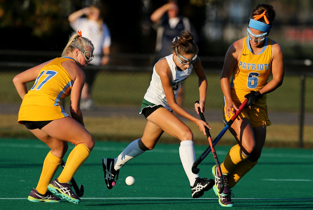 First Colonial's Katie Needham, left, and teammate Delaney Versprille converge on Cox's Sam Zywna during the Patriots' 2-1 win to claim the Class 6 Region A championship, Friday, Nov. 3, 2017 at the National Training Center in Virginia Beach.