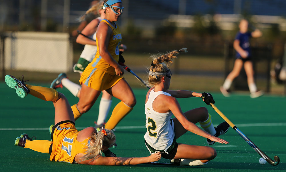 First Colonial's Katie Needham, left, and Cox's Leah Crouse hit the turf while going for a loose ball during the Patriots' 2-1 win to claim the Class 6 Region A championship, Friday, Nov. 3, 2017 at the National Training Center in Virginia Beach.