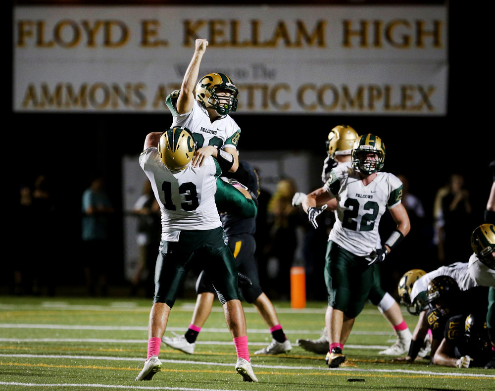 Cox's Carson DiNardo is hoisted in the air by teammate Cameron Wallace after DiNardo hit the go-ahead field goal with 2.6 seconds on the clock in the Falcon's 38-35 win over the Knights, Friday, Oct. 6, 2017 at Kellam High School in Virginia Beach.