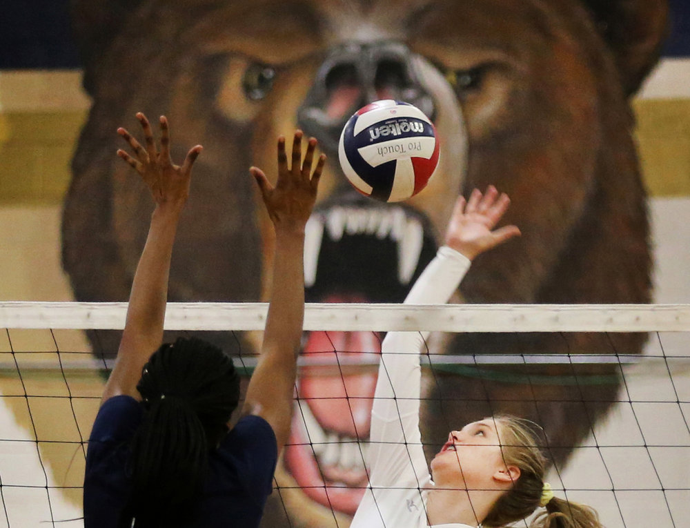 Grassfield's Erika Anderson, right, hits a winner past Western Branch's Michelle Debroux during the Grizzlies' 3-0 sweep, Thursday, Oct. 19, 2017 at Western Branch High School in Chesapeake.