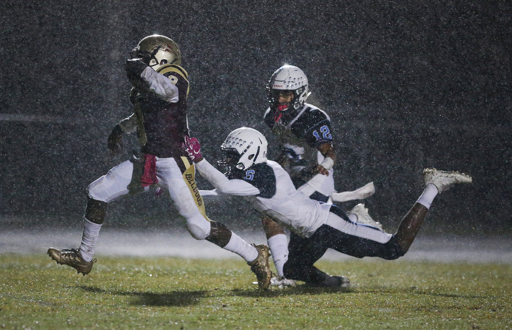 King's Fork's Darran Butts breaks past Indian River's Demetri Payne, center, and Isaiah Hyman for a first quarter touchdown, Friday, Oct. 13, 2017 at King's Fork High School in Suffolk.