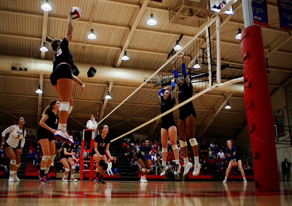 Princess Anne's Jayna Francis soars and drills a winner past Atlee's Olivia Guridy and Brianna Brown, right, during the Cavaliers' three-set sweep in the Class 5 state semifinal, Tuesday, Nov. 14, 2017 at Princess Anne High School in Virginia Beach.