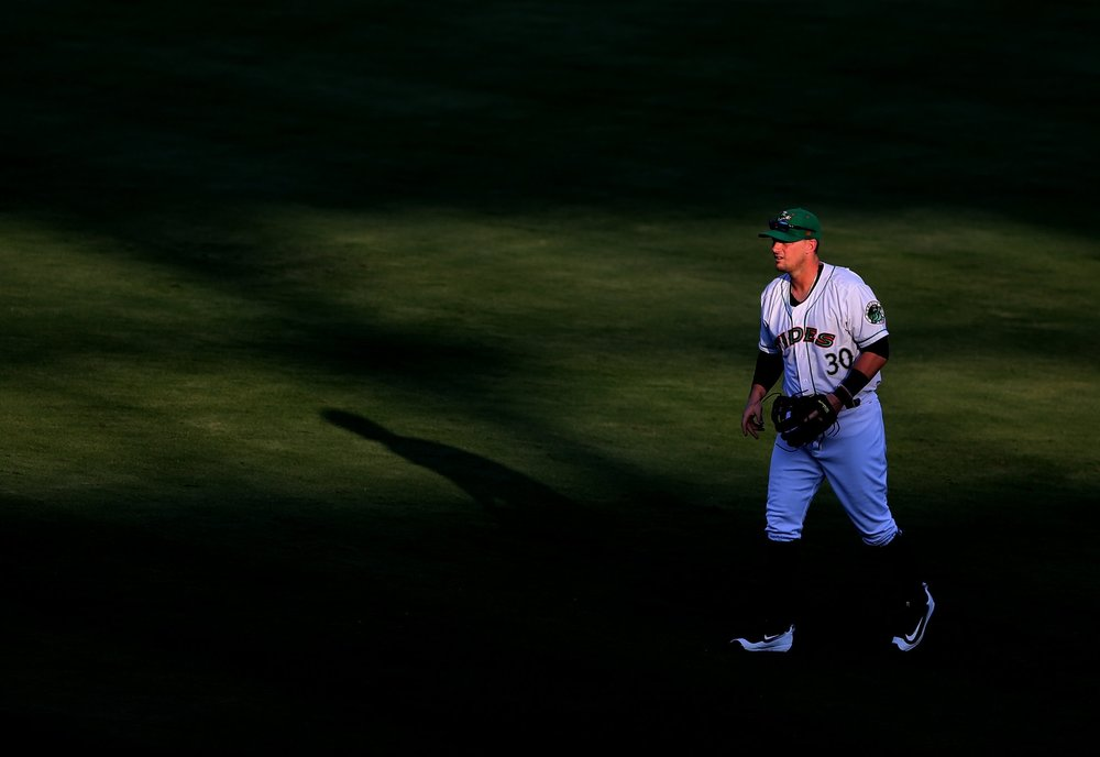 Tides second baseman stands in short right field while playing the shift defense against Scranton's Jake Cave, Monday, July 24, 2017 at Harbor Park in Norfolk. Cave is a Hampton native.