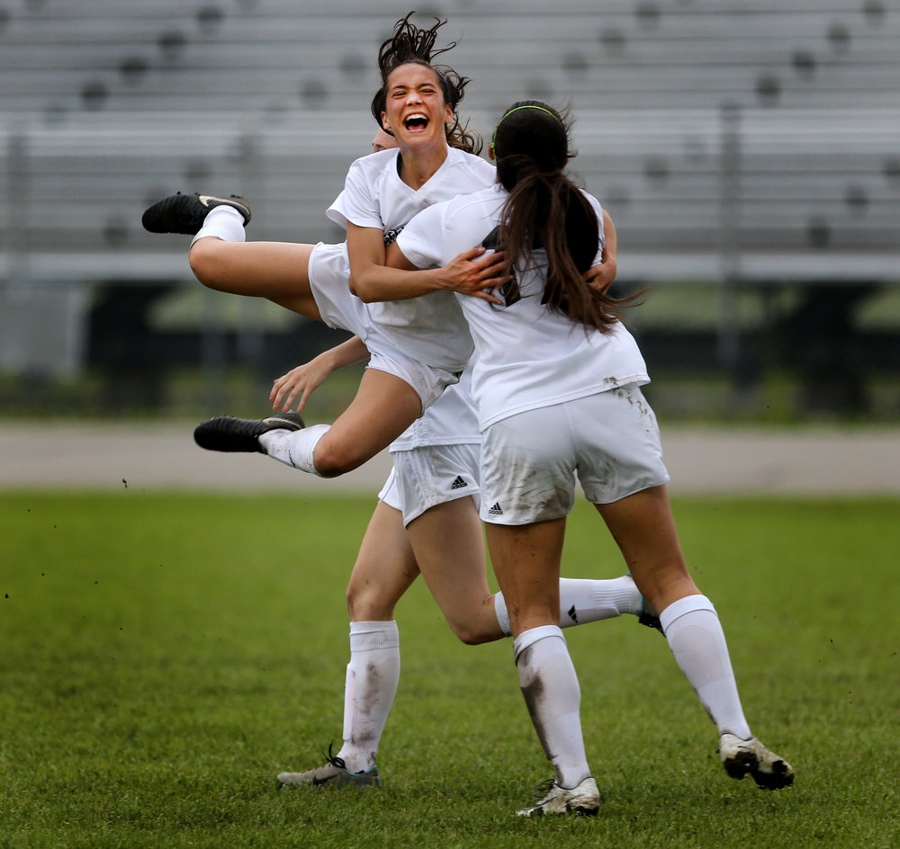 Hickory's Ashley Trotter celebrates with a teammate in the Hawks' 3-1 over Nansemond River, Thursday, May 18, 2018 at Hickory High School in Chesapeake.
