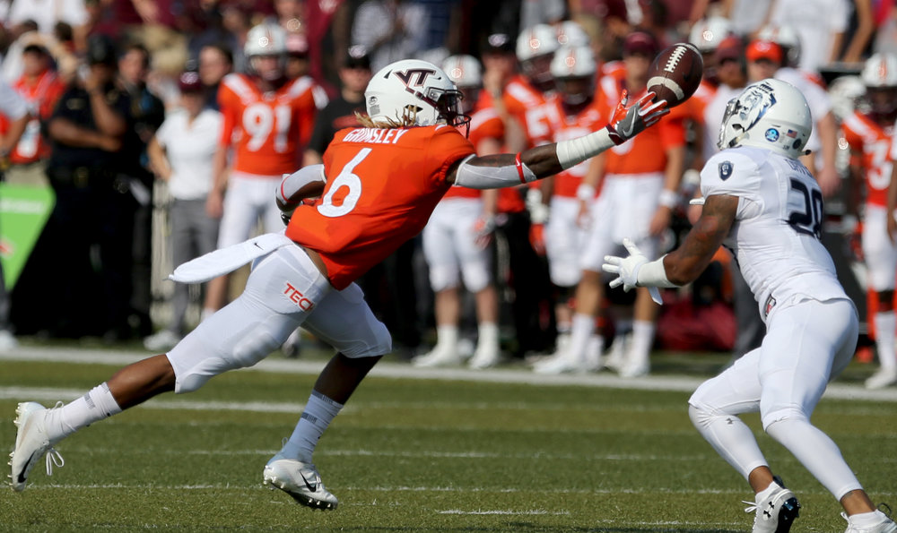 Virginia Tech's Hezekiah Grimsely, left, nearly intercepts a pass intended for Old Dominion's Justice Davila during the first half of an NCAA college football game Saturday, Sept. 22, 2018, in Norfolk, Va. (AP Photo/Jason Hirschfeld)
