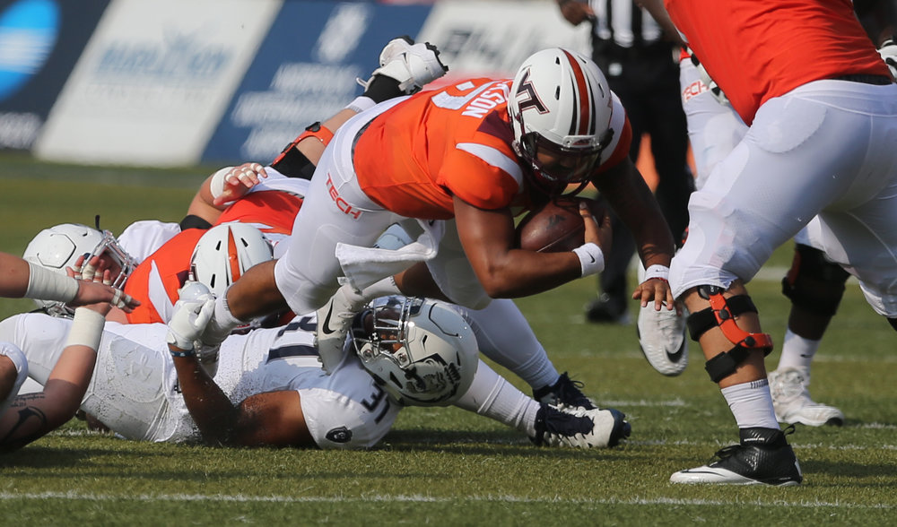 Virginia Tech's Josh Jackson dives for a first down after being tripped up by Old Dominion's Sean Carter during the first half of an NCAA college football game, Saturday, Sept. 22, 2018, in Norfolk, Va. Old Dominion won 49-35. (AP Photo/Jason Hirschfeld)