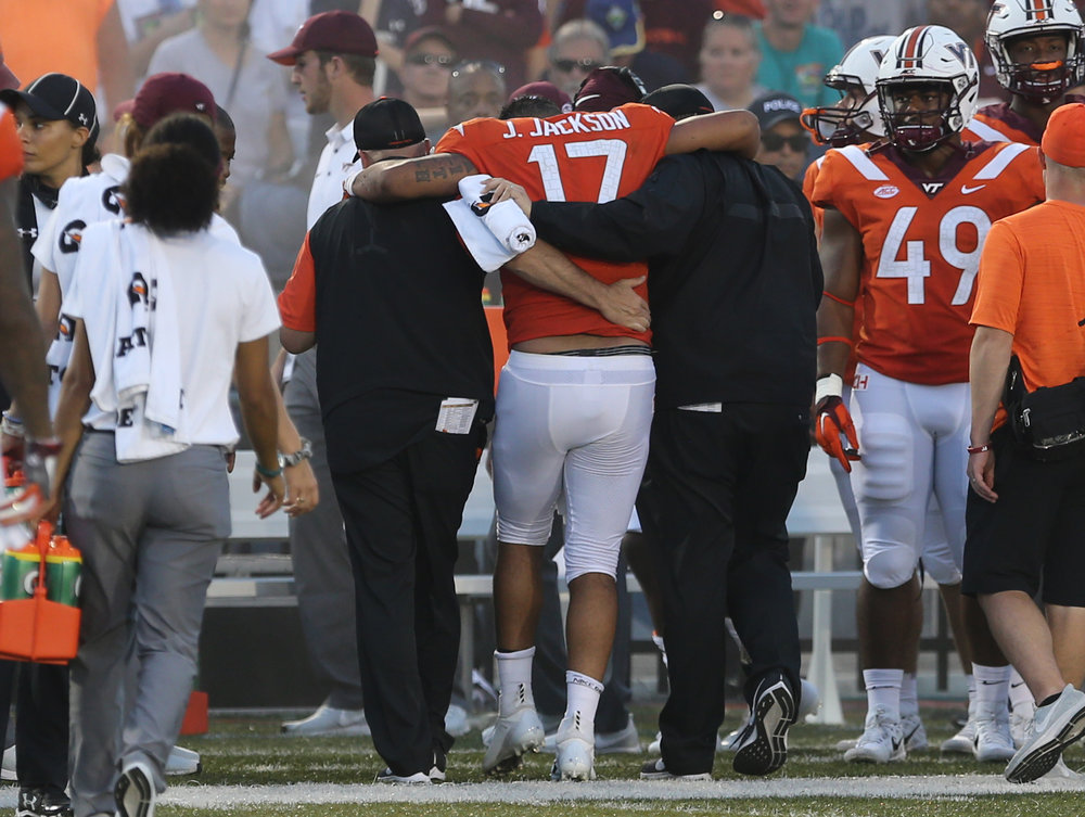 Virginia Tech quarterback Josh Jackson is helped off the field during the second half of an NCAA college football game Saturday, Sept. 22, 2018, in Norfolk, Va. Old Dominion won 49-35. (AP Photo/Jason Hirschfeld)