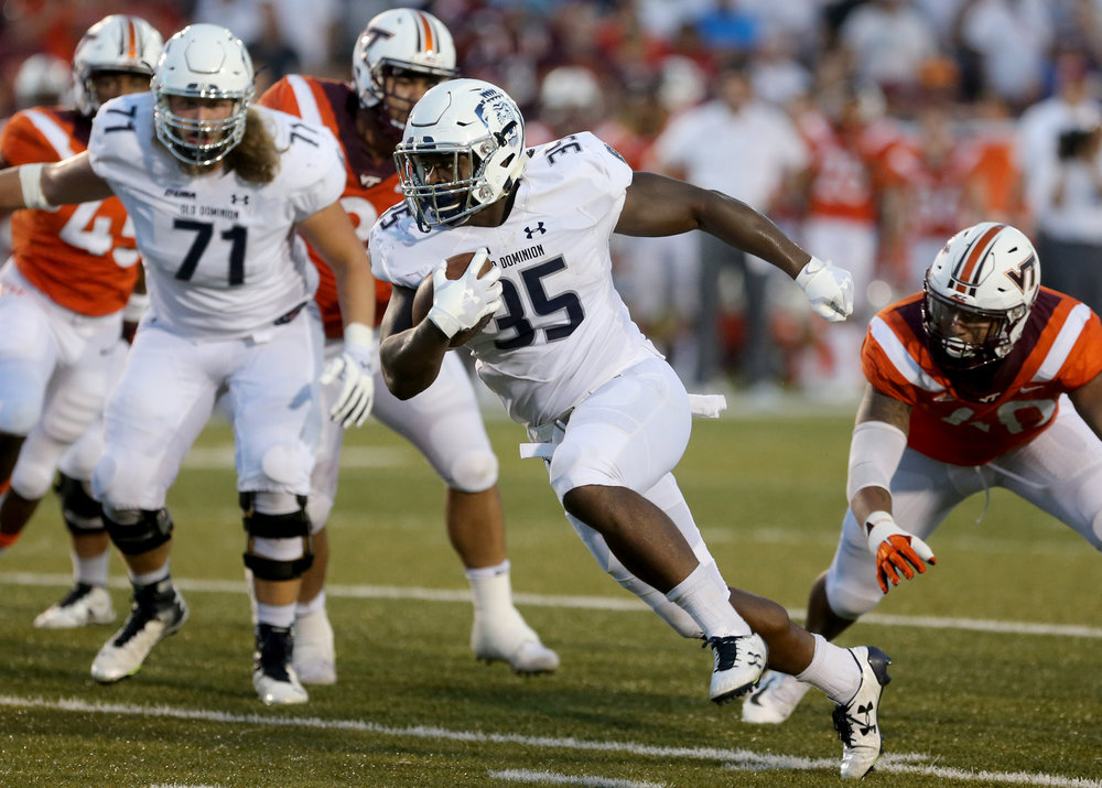 Old Dominion's Jeremy Cox runs for a first down against Virginia Tech during the second half of an NCAA college football game Saturday, Sept. 22, 2018, in Norfolk, Va. Old Dominion won 49-35. (AP Photo/Jason Hirschfeld)