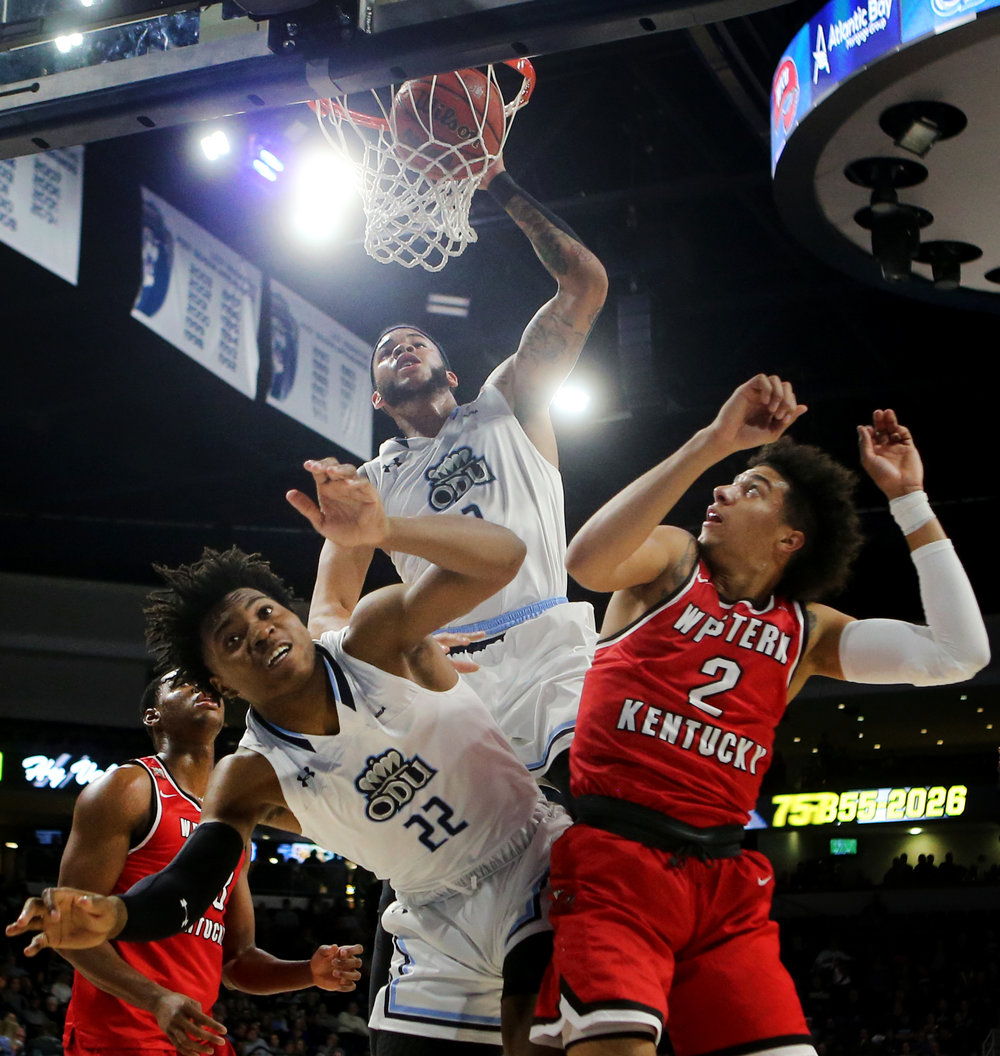 Old Dominion's B.J. Stith dunks the ball over the backs of teammate Kalu Ezikpe, left, and Western Kentucky's Jared Savage during the first half, Saturday, January 5, 2019 at the Constant Center in Norfolk.