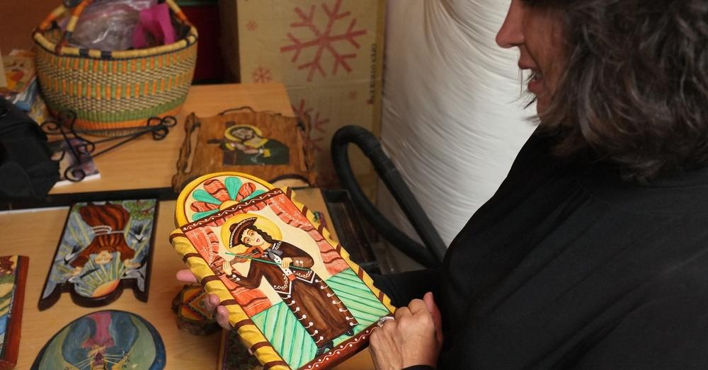 Teresa Duran holding a retablo. Photo by Amitai Malone, 2013