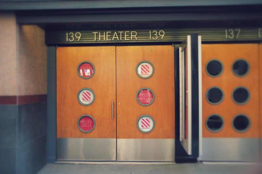 HELEN MILLS Theater decorated with logos in portholes.